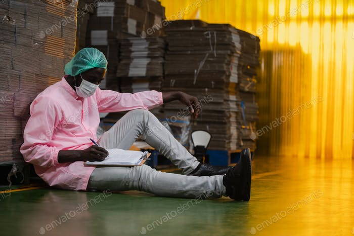 African American inspection worker engineer are work in drink water manufacturing factory