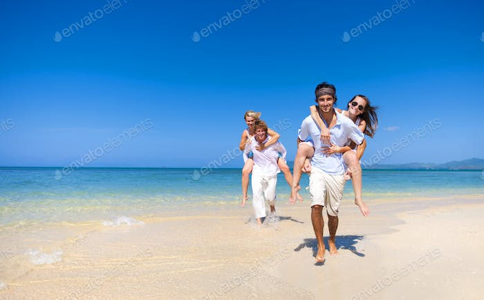 Caucasian couples at the beach