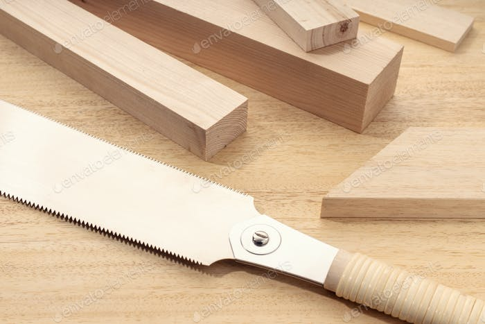Group of assorted Wood material and a japanese hand saw