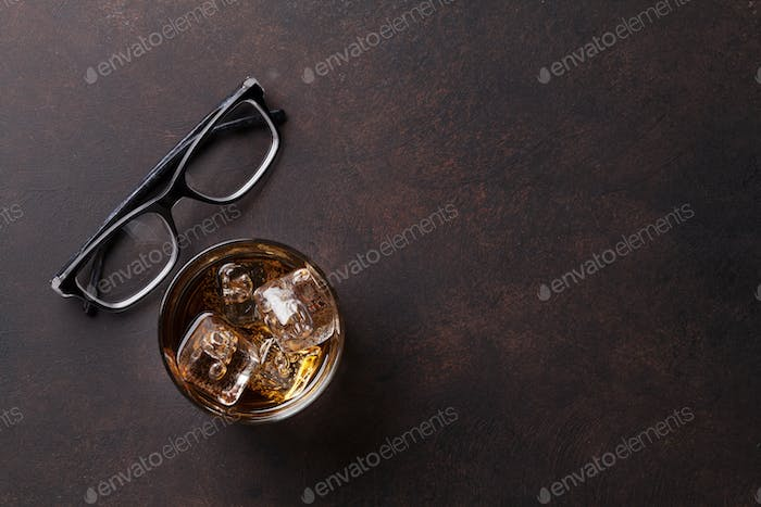 Whiskey with ice and eyeglasses