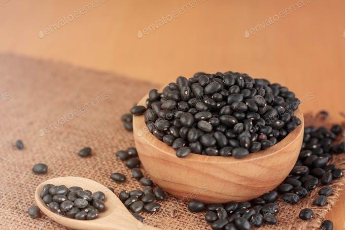 Black beans on wooden