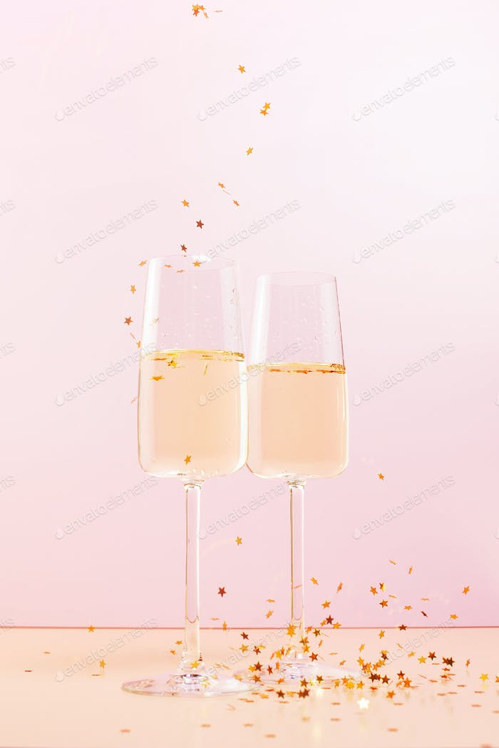 Two Glasses of Campagne and Golden Confetti Stars