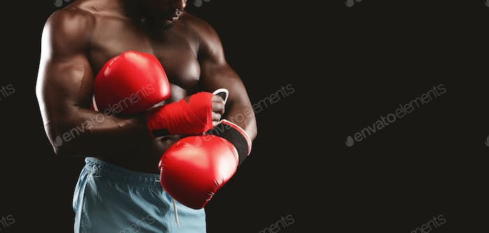 Cropped photo of boxer wearing red gloves