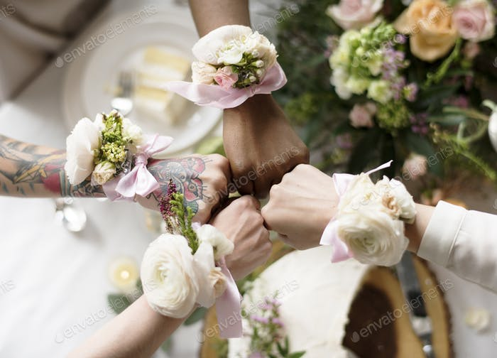 Bridesmaids Showing Flower Bouquets on their Writst