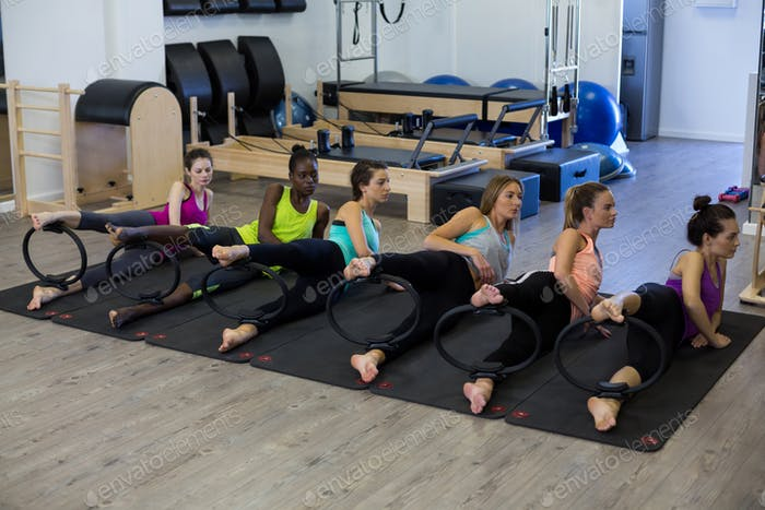 Group of women exercising with pilates ring
