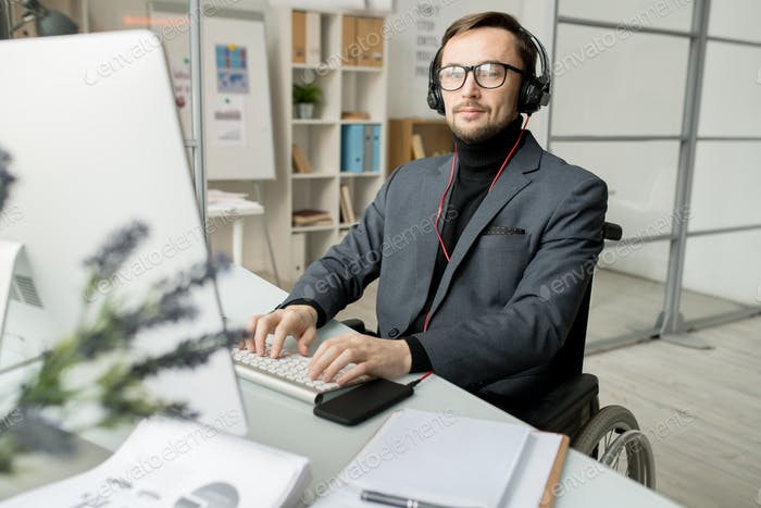 Disabled businessman working on computer
