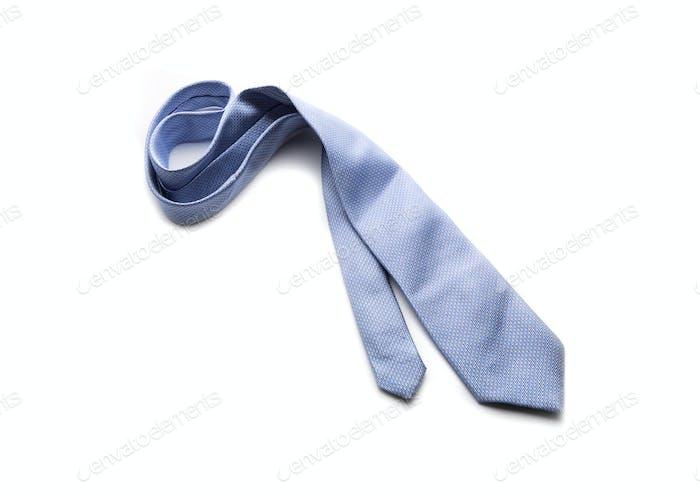 Blue necktie on a white