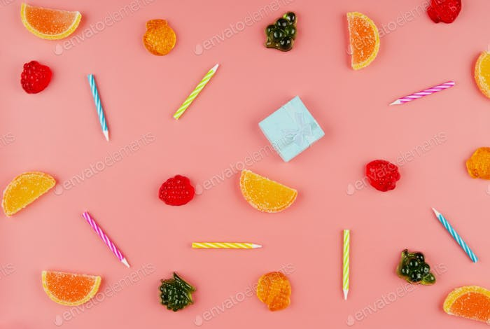 Flat lay view at sweet background of different type candies on pink