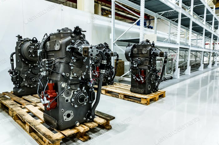 Disassembled tractor parts on the modern tractor factory