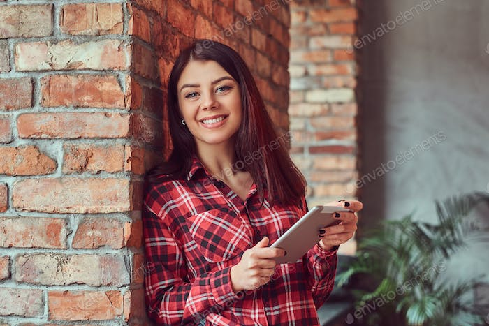 Brunette student girl in a room with loft interior