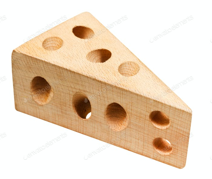 wooden model of cheese with holes