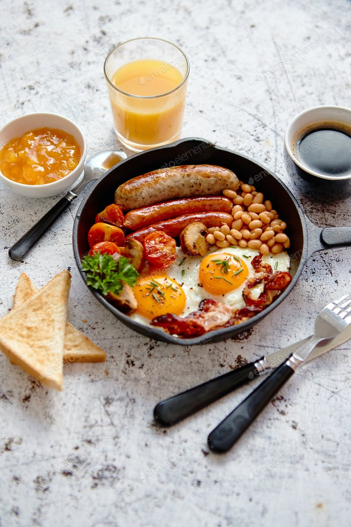 Full English breakfast on bright rusty background