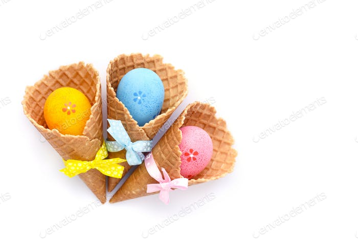 Waffle Cones with Easter eggs on white background. Space for tex