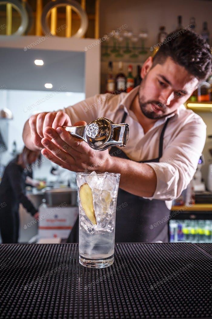 Professional bartender making cocktail