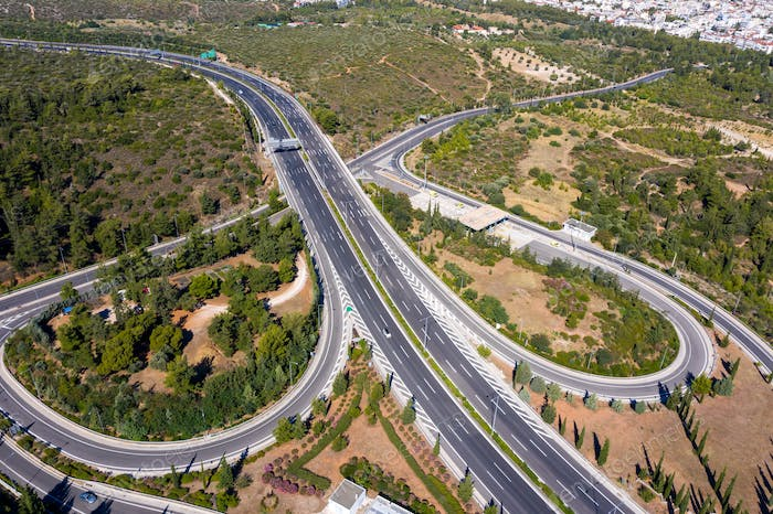 Aerial drone view of regional highway of Hymettus mountain, Greece, Athens city background.