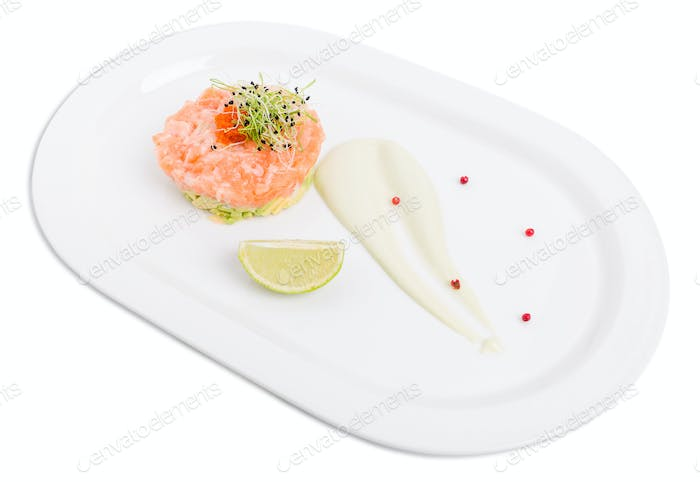 Salmon tartare with avocado and red caviar.