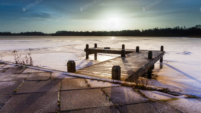 Winter landscape frozen lake sunrise