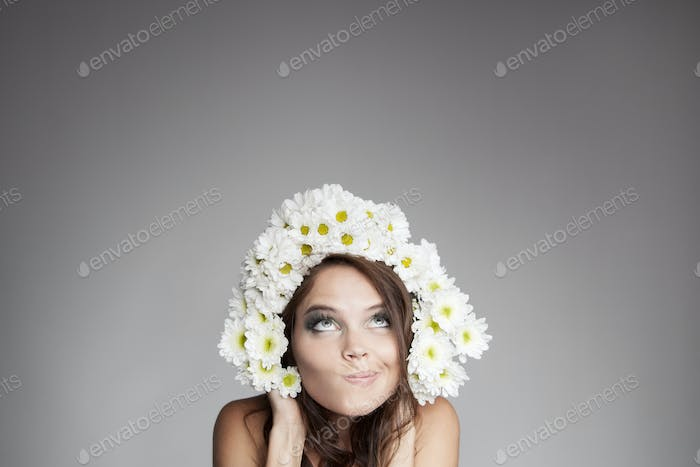 Surprised Thinking Woman With Flower Wreath Looking Up