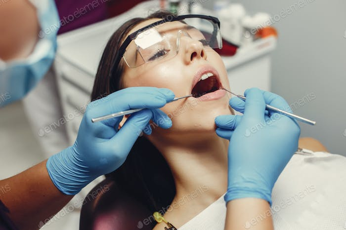 Beautiful girl in a dentist