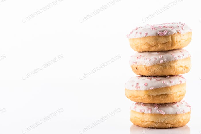 White Chocolate Donut or Doughnuts on White Reflective Background with Copy Space