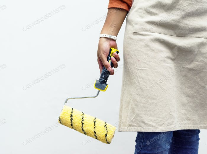 Paint holding a new paint roller