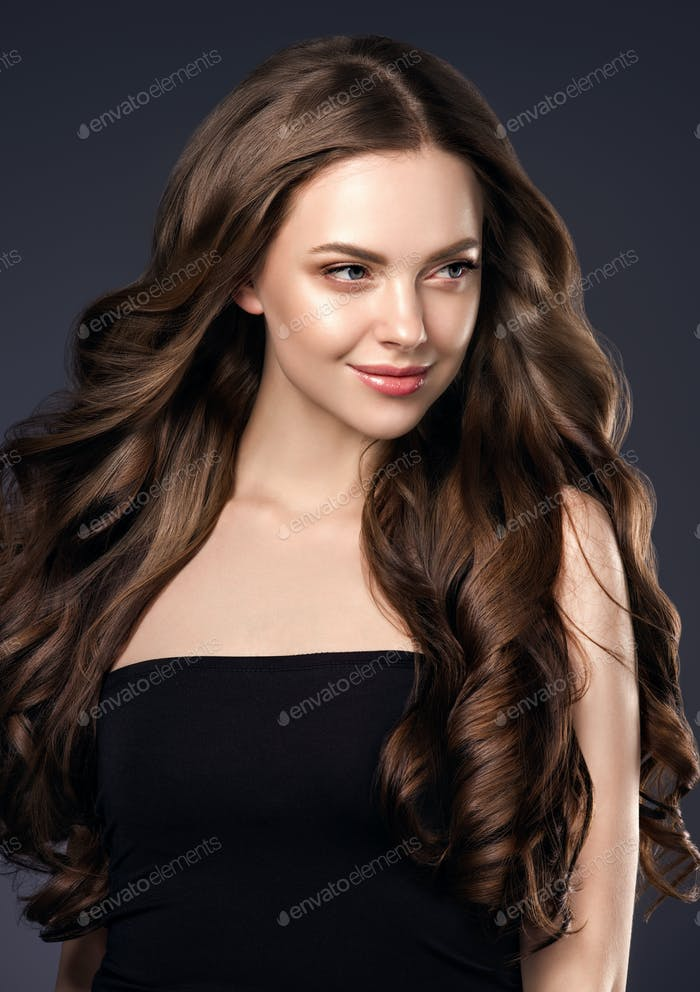 Beauty long hair woman curly hairstyle natural makeup