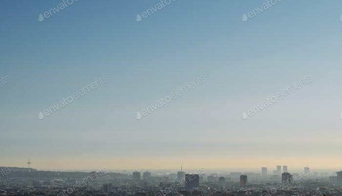 Foggy cityscape at dawn