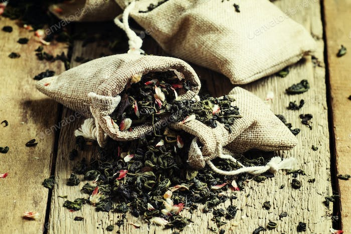 Dry green tea with flower petals in canvas bags