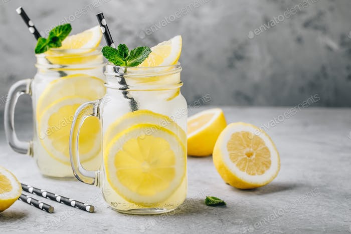 Thumbnail for Homemade refreshing summer lemonade drink with lemon slices and ice in mason jars