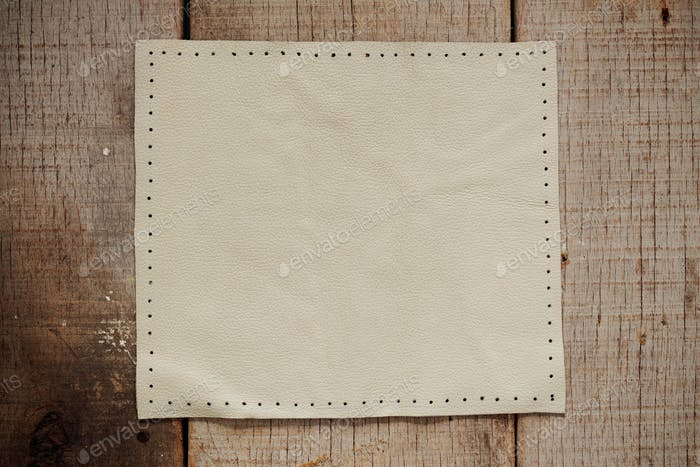 White leather on wooden
