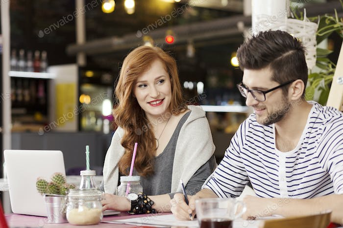 Freelance couple enjoying coffee break