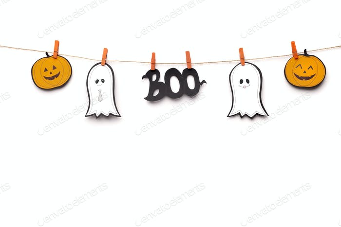 Halloween cut out smiling figures hanging on rope