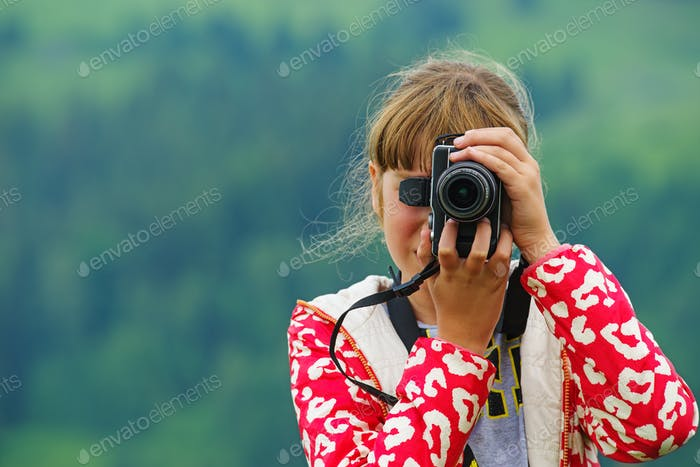 Girl with digital camera