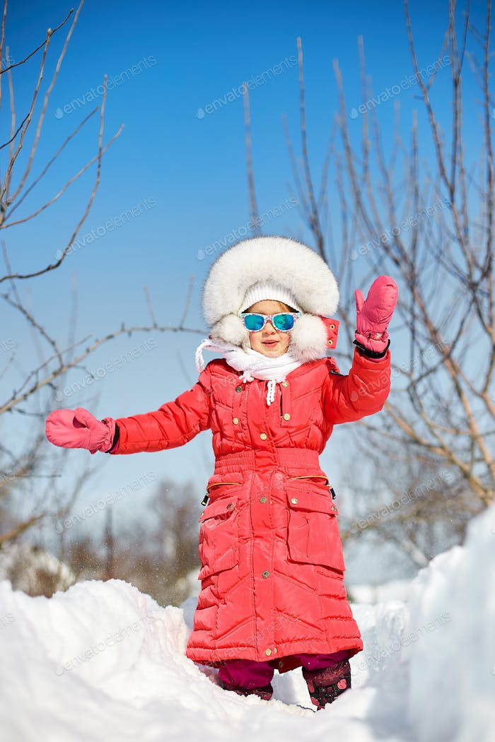 Cute little girl in winter, have fun and enjoy