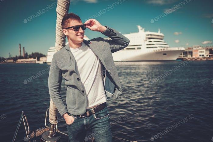 Young man enjoying ride on a yacht