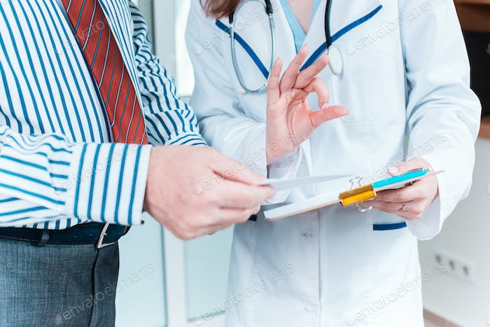 Close-up of doctor and patient hands