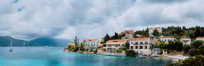 Superb scene of Fiskardo town with Zavalata Beach. Seascape of Ionian Sea on overcast day. Tranquil