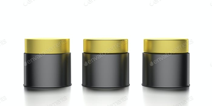 Glass cosmetic jars with golden covers isolated against white background. 3d illustration