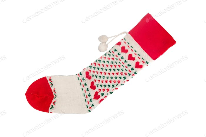 Christmas socks with heart shaped stitches in green background.