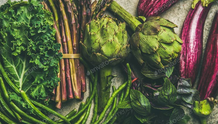 Flat-lay of fresh green and purple vegetables, clean eating