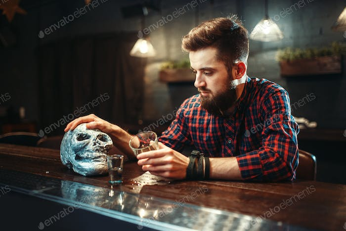 Sad man at the bar counter, alcoholism, depression