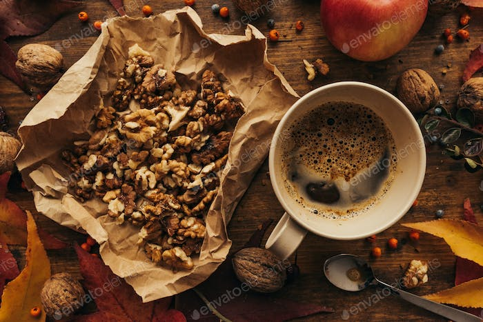 Thumbnail for Enjoying fruits of autumn - apple, coffee and walnut on table