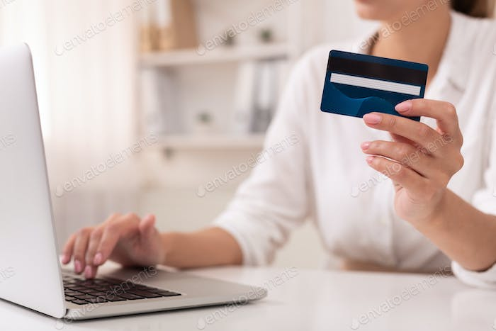 Unrecognizable Office Girl Using Credit Card And Laptop At Workplace