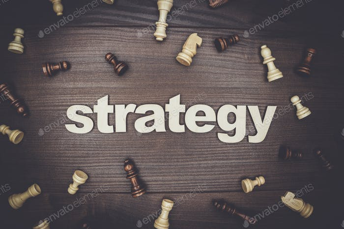 word strategy on wooden background