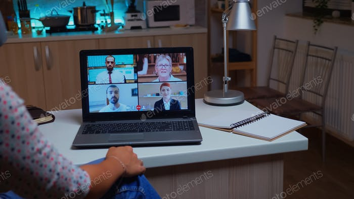 Woman talking with coworkers during virtual meeting