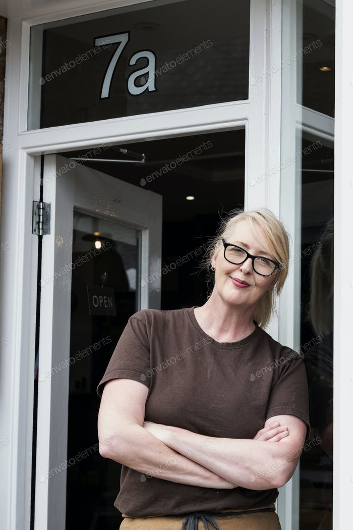Waitress at the entrance to a cafe