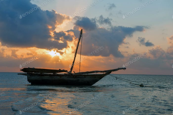 Beautiful tropical sunset with boat