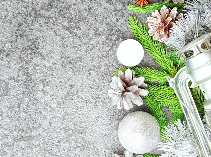 Christmas and Happy New Year gray stone background. Top view, copy space, military stile.