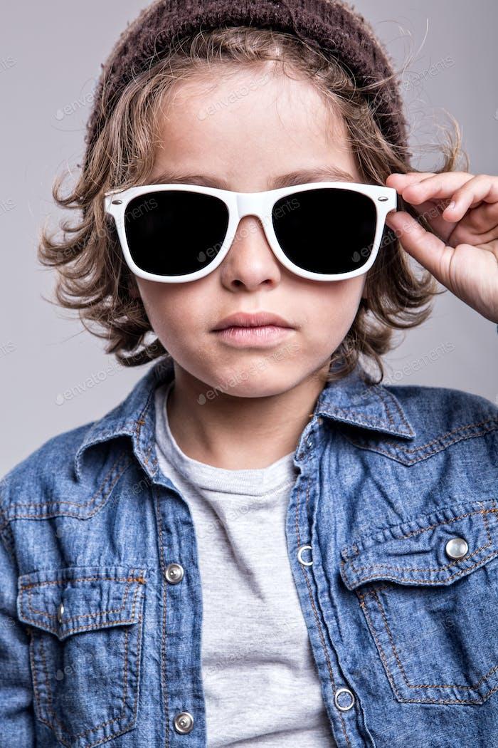 Boy wearing white sunglasses