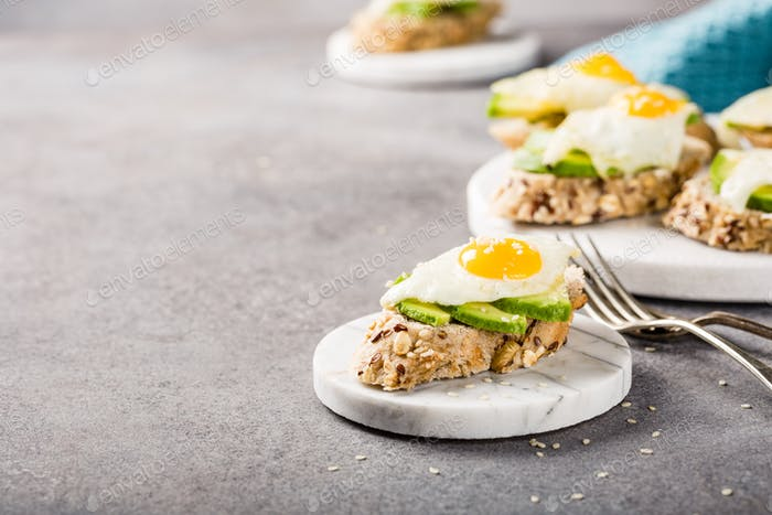 Sandwich with avocado and fried eggs